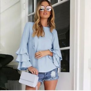 Tops - Last! On trend ruffled sleeves blouse.